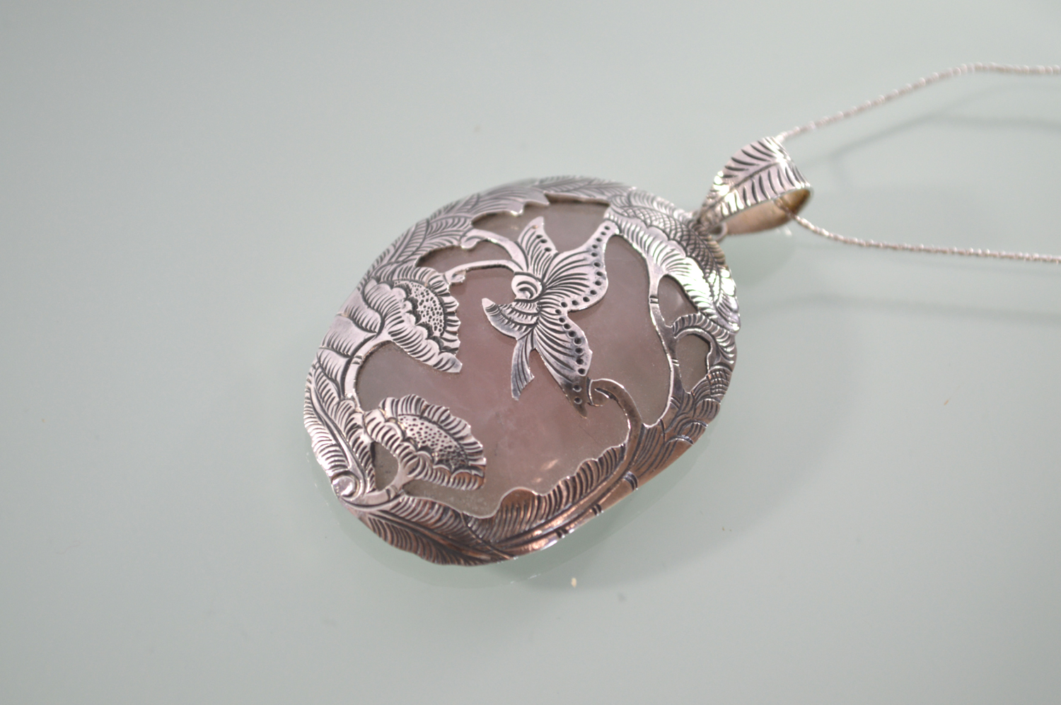 Butterfly embossed sterling silver and rose quartz pendant bali mantra silver rose quartz pendant silver rose quartz pendant angled mozeypictures